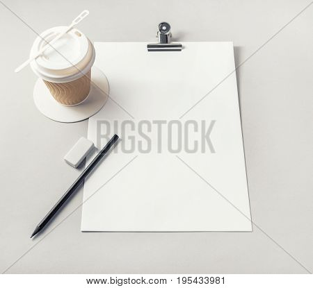 Blank letterhead pencil eraser and coffee cup on paper background. Responsive design mockup. Stationery elements. Template for placing your design.