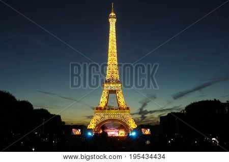 PARIS, FRANCE - JULY 14, 2017: Famous Eiffel Tower is one of the most visited monuments during celebrations of French national holiday - Bastille Day.