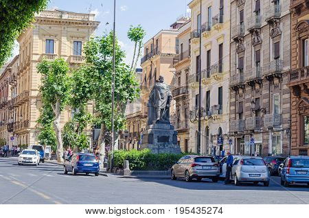 Catania, Italy - July 3 2017: View of one of the central streets - Via Etnea - with the statue of Giuseppe Garibaldi by Ettore Ferrari cars and pedestrians.