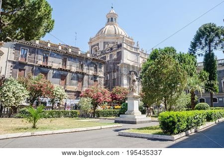 The square of Catania Cathedral dedicated to Saint Agatha with its typical Sicilian Baroque style decorated with marble statue. The Baroque city centre of Catania is a UNESCO World Heritage Site. Italy Sicily.