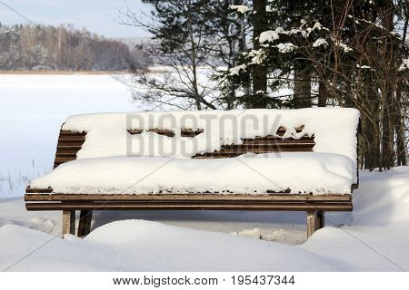 View of the bench in the winter park