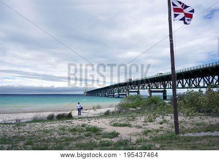 MACKINAW CITY, MICHIGAN / UNITED STATES - JUNE 18, 2017: The Mackinac Bridge spans the Straits of Mackinac, between Lakes Michigan and Huron, to connect Michigan's Lower and Upper Peninsulas, from Mackinaw City to St. Ignace.