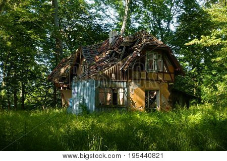 Abandoned broken house in the wood