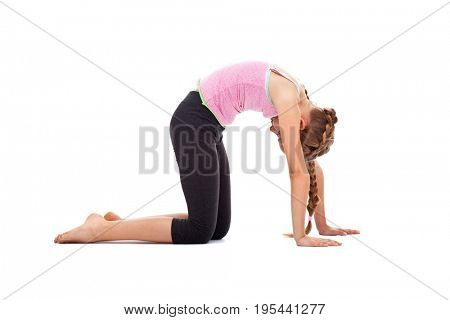 Young girl doing flexibility and warming up gymnastic exercises - isolated