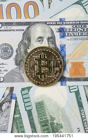 Photo of dollars with golden bitcoin
