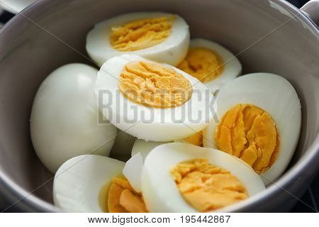 Tasty hard boiled eggs in bowl, closeup. Nutrition concept