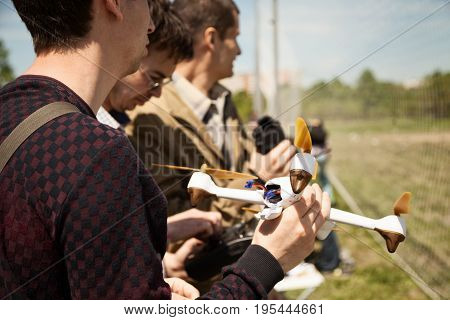Khabarovsk Russia - May 21 2017: Quadcopter pilots at a drone racing. Young man holding a multicopter