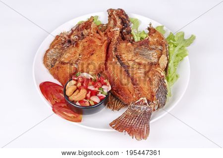 Thai cuisineDeep fried Tilapia with spicy and sour herb salad .