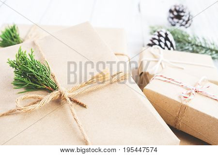 Christmas background - Craft and handmade Christmas present (gift boxes) and rustic decoration. Vintage style. Selective focus and shallow.