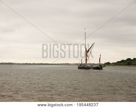 A London Barge Sailing down the River Colne into open Sea; Essex; UK