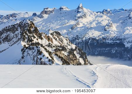 Summits of Alps in Switzerland - wintertime view from the Fronalpstock mountain in the Swiss canton of Schwyz.