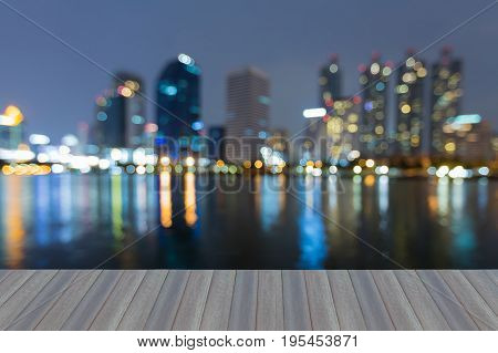 Opening wooden floor Refleciton blurred bokeh light office building night view abstract background