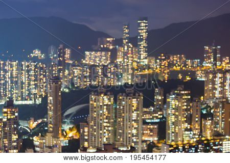 Night light city of Hong Kong blurred bokeh light residensce area over high hill abstract background