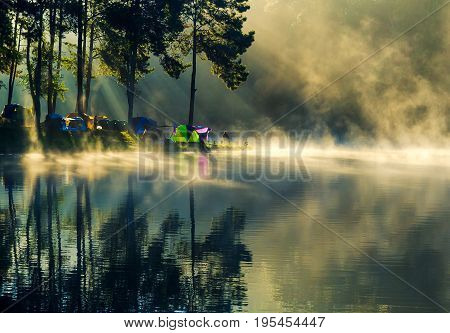 Pang Ung Thailand is a tourist place where people come to vacation in the winter. Because of the large reservoir The cold causes steam to rise above the surface.