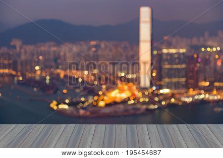 Opening wooden floor Aerial view blurred bokeh light Hong Kong city downtown abstract background