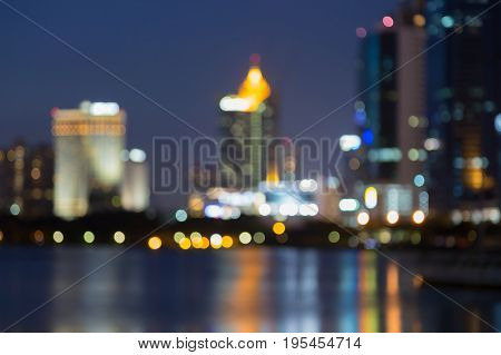 Twilight blurred office building downtown water front abstract background