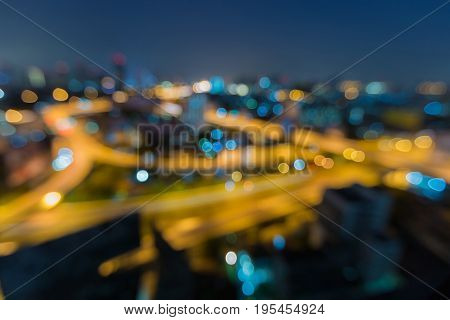Aerial view blurred bokeh light over city road intersection abstract background