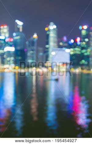 Night light office building blurred bokeh sea front reflection light night view abstract background