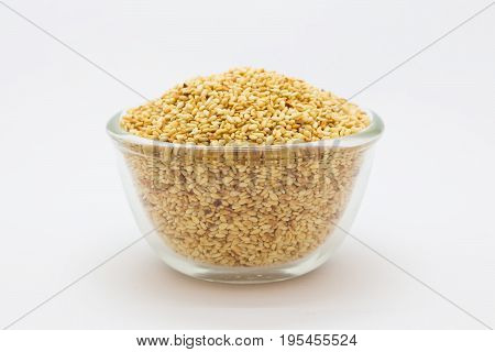 Sesame seed on a glass cup on white background