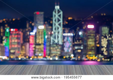 Opening wooden floor Office building central business downtown blurred bokeh light nigh view Hong Kong city abstract background
