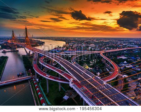 Road roundabout with car lots in Thailand.Bhumibol Bridge in Thailand.