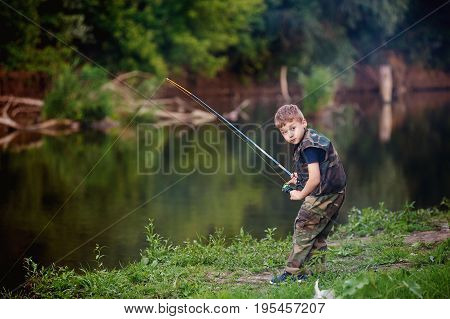Boy catches fish in the river.The concept of tourism and leisure