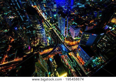 The light on the road at night and the city in Bangkok Thailand on March 31 2015. Building of light and power of the car is beautiful.
