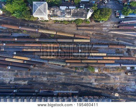 Freight and passenger train waiting at the train station parking lot.Cargo transit.import export and business logistic.Aerial view.