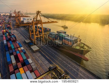 containercontainer ship in import export and business logistic.By crane Trade Port Shipping.cargo to harbor.Aerial view.Water transport.International.Shell Marine.transportation.businesslogistic.
