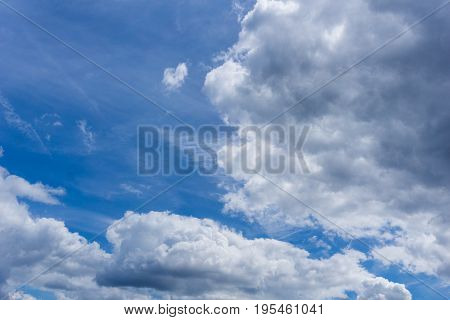 View on beautiful white Clouds on a Blue Sky. Close-up of Big Skies in the Morning. Cloud Formations.  Natural Background.