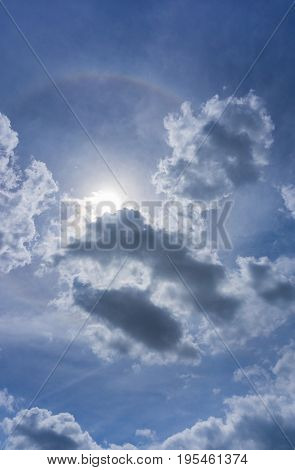 View on beautiful white Clouds on a Blue Sky. Close-up of  Skies in the Morning. The Sun behind Clouds. Cloud Formations. Natural Background