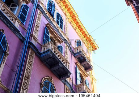 The Facade Of A Building In The Sunset