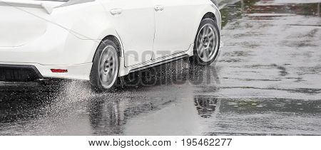 Emergency braking car on wet road .