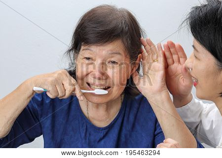 Asian seniors woman hearing loss , Hard of hearing .