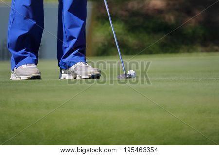golfer putting, selective focus on golf ball .