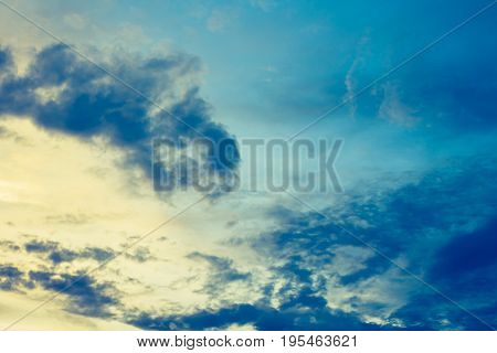 vintage tone image of blue sky and white clouds on day time for background usage.(horizontal)