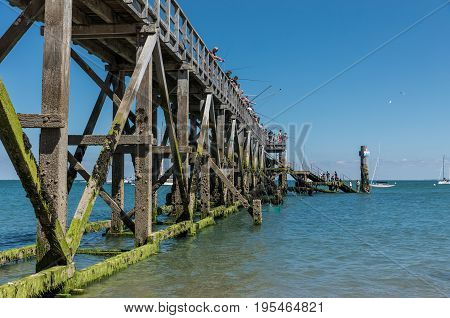 Fishermen on the landing stage of Noirmoutier (France)