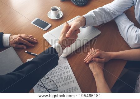 Young couple consultation with agent purchase rent property real estate handshake