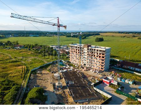 Aerial view of multi-storey building construction at summer time