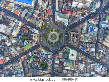Aerial view Road roundabout Expressway with car lots in the city in Thailand. beautiful Street downtown cityscape Top view. Background