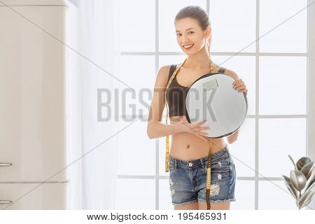 Young female weight loss perfect body holding scacles