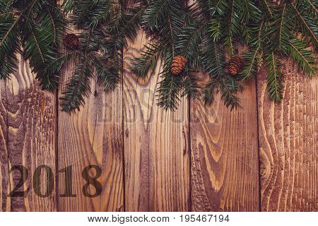 Fir Tree Branches On Rustic Wooden Background. Christmas Holiday Concept.