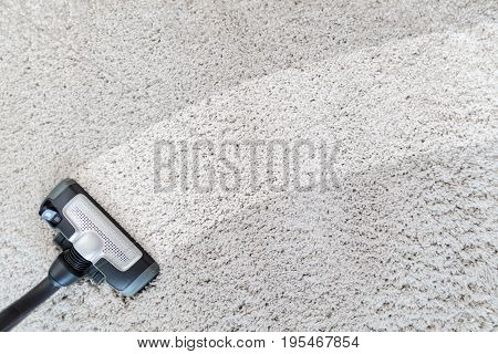 Cleaning carpet hoover. Carpet texture background. Vacuuming and cleaning.
