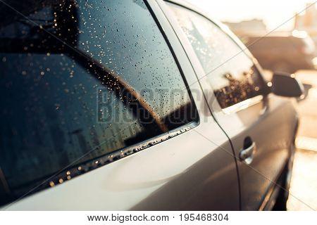 Wet car window after wasing closeup