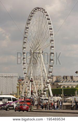 ParisFrance- April 29 2017:The Paris wheel on the Place de la Concorde. By area moving vehicles and pedestrians