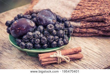 Ripe aronia and aromatic plum. Autumn concept. Garden harvest.