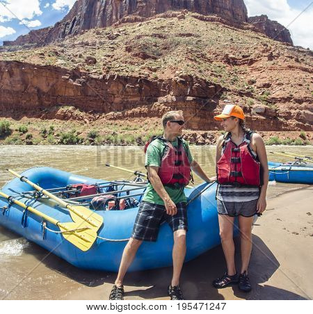 Couple on a rafting trip together down the scenic Colorado River near Moab, Utah