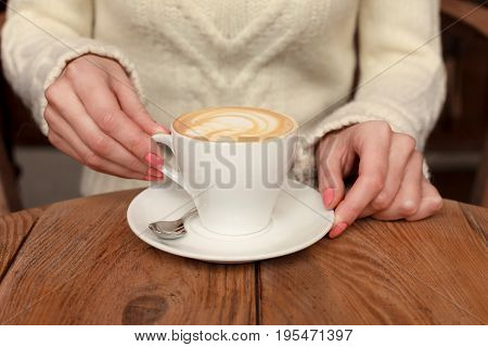 Close-up Female Hands Holding Cup With Coffee Cappuccino With Foam With Nice Pattern. Perfect Red Ge
