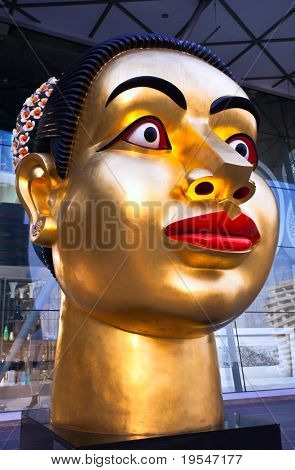 BANGKOK - NOVEMBER 25:Sculpture of Indian woman's head, dedicated to the 80th Birthday of His Majesty King Bhumibol Adulyadej  on 25 November 2009 from  India-Thai chamber of commerce, Bangkok