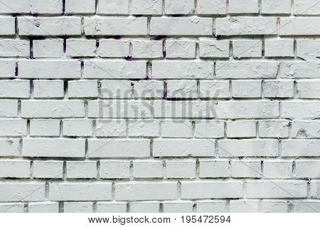 City old dirty painted brick wall, prepared for drawing creative graffiti. Can be useful for backgrounds